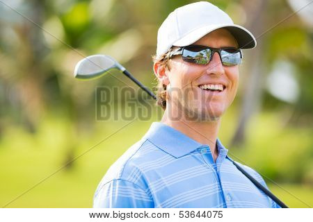 Athletic young man playing golf, Portrait of Golfer on Course with driver