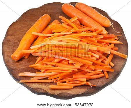 Raw Cleaned And Strips Sliced Carrots On Board