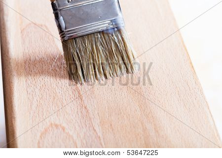 Putting Varnish On Beach Wooden Board