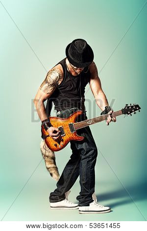 Rock musician is playing electrical guitar.