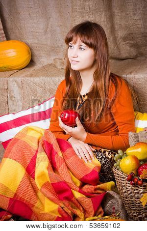 Young Pretty Woman Holds An Apple