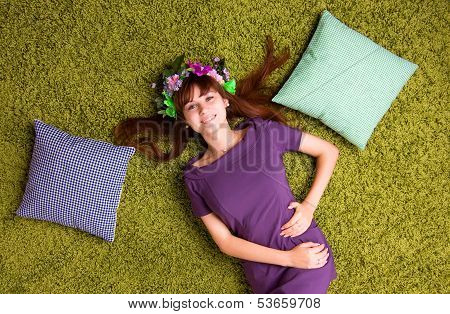 Young Woman Lies On The Carpet