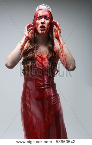 Horror Image of a Woman Dripping in Blood Wearing Prom Dress