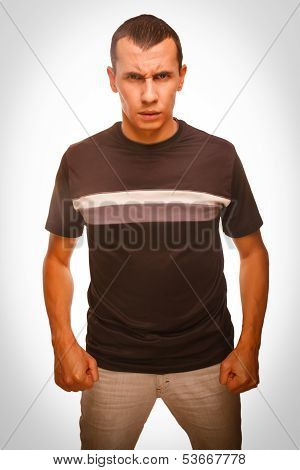angry man young brunette hands clenched fists isolated on white