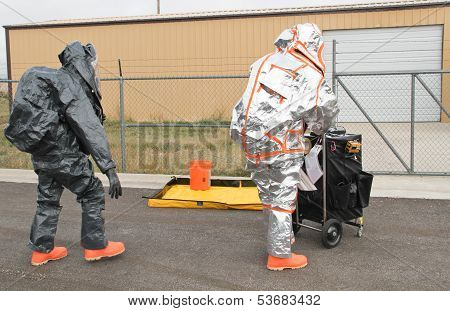 men approaching hazmat site