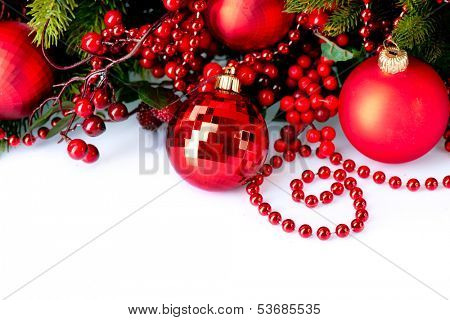 Christmas. Christmas and New Year Baubles and Decorations isolated on White Background.Holiday Border Design Composition with Christmas tree and Holly Berry. Red Color
