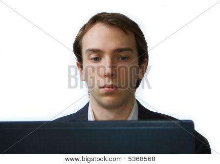 Close Up Of Young Man Working On Laptop