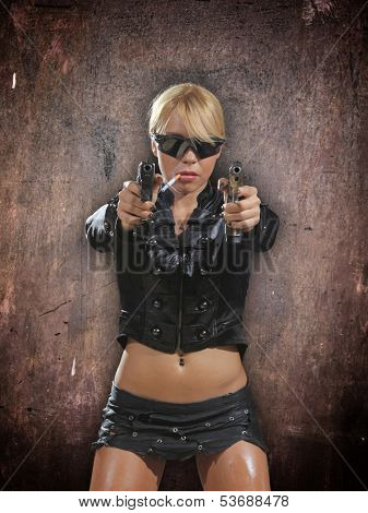 Beautiful sexy blonde girl with gun