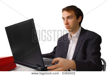 Young Man Holds Laptop And Cannot Take More