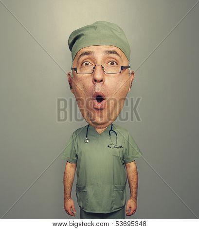 bighead amazed doctor in uniform over grey background