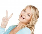 happy people concept - young woman showing victory or peace sign