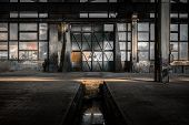 stock photo of trough  - Industrial interior of an old factory building - JPG