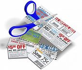 stock photo of coupon  - Coupon cutting scissors cut out money saving retail store coupons for discounts - JPG