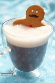 picture of ginger man  - Gingerbread cookie men in a hot cup of cappuccino - JPG