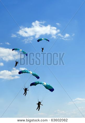 Unidentified Skydiver On Blue Sky