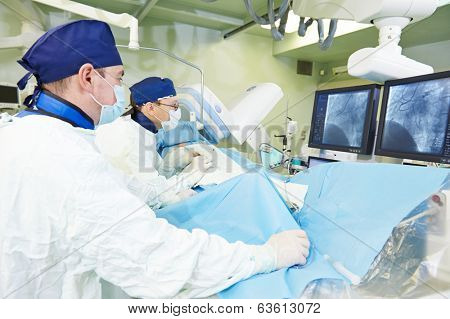 Team of vascular surgeon in uniform perform operation on a patient at cardiac surgery clinic