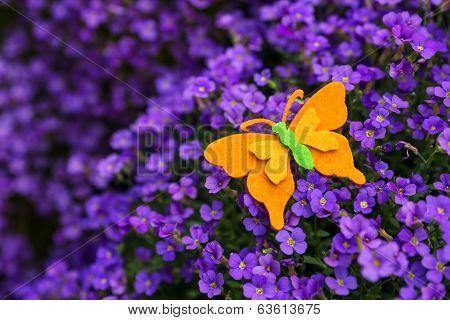 Felt Butterfly Atop A Violett Lilacbush