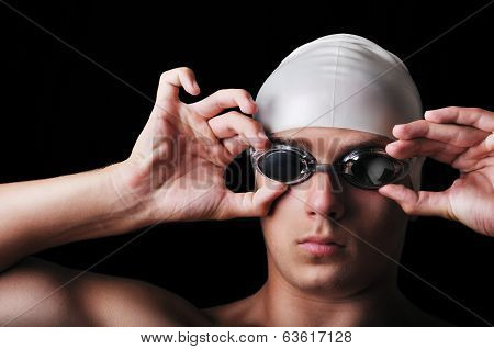 Portrait of male swimmer isolated on black