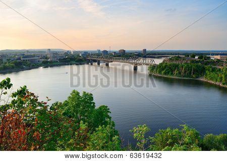 Alexandra Bridge over river in Ottawa at sunset
