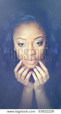 Close up photo of young woman's face and hands