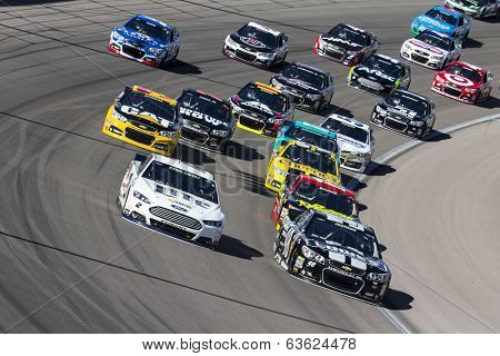 Las Vegas , NV - Mar 09, 2014:  Brad Keselowski (2) and Jimmie Johnson (48) battle for position during the Kobalt Tools 400 race at the Las Vegas Motor Speedway  in Las Vegas , NV.