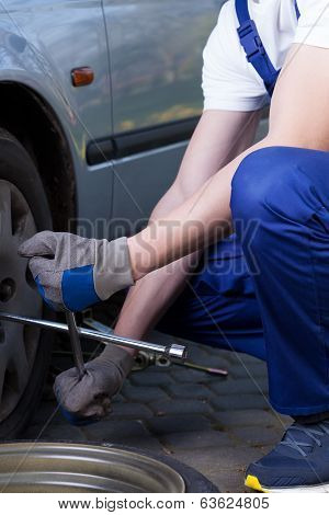Changing Flat Tyre In Garage