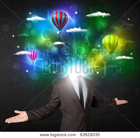 Man in suit with glowing dreamy cloudscape concept