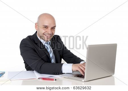 Bald Happy Latin Businessman Working On Laptop Smiling Camera