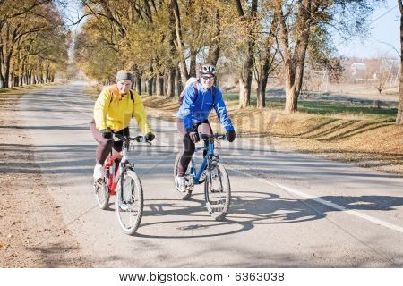 Couple On Road With Bikes