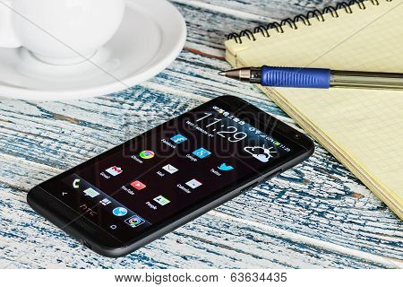 Htc Mobile Phone With Android Applications On The Desktop