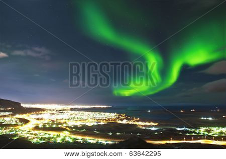 The Northern lights above Reykjavik city, Iceland