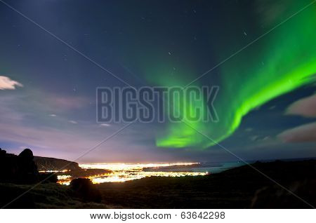 The Northern lights above Reykjavik city, Iceland