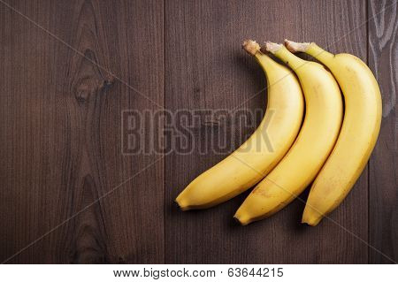 banana on the brown wooden background
