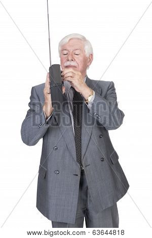Old Man In Suit And Gray Hair Listening To A Radio