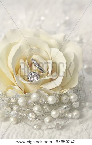 Wedding rings in cream rose flower