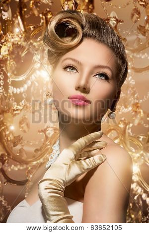Luxury Styled Beauty Lady Portrait. Retro Woman. Beauty Fashion Vintage Style Girl with Beautiful Luxury Hairstyle, makeup, accessories. Golden Silk Gloves and dress