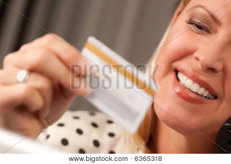 Beautiful Woman On Phone Holding Credit Card