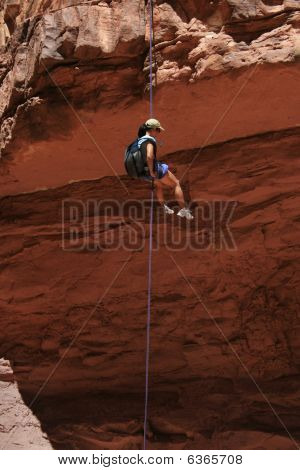 Asian Woman Rappeling