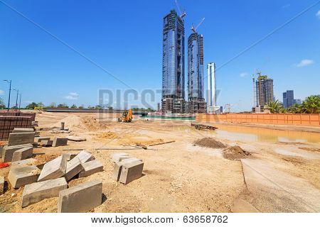ABU DHABI, UAE - MARCH 27: Building constuction in Abu Dhabi on March 27, 2014, UAE. Abu Dhabi is the capital and the second most populous city in the United Arab Emirates with around 1 million people