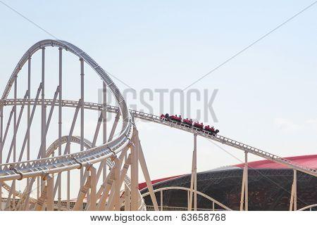 ABU DHABI, UAE - MARCH 27: Roller coaster at Ferrari World on Yas Island in Abu Dhabi on March 27, 2014, UAE. Ferrari World is the largest indoor amusement park in the world.