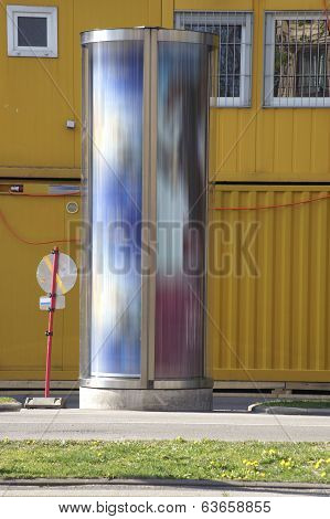 Advertising pillar and Container