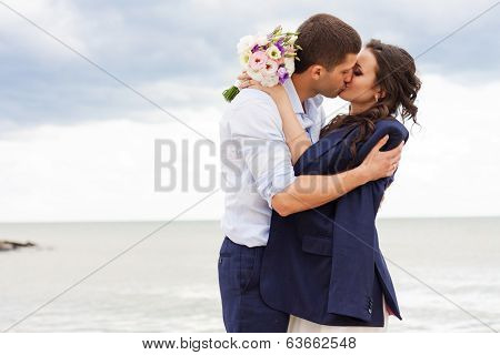 Romantic bride and groom near the sea.