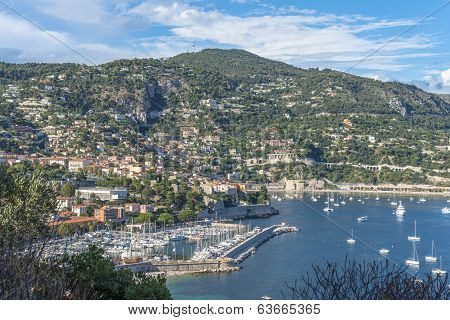Aerial View Of Villefranche-sur-mer Coast With Yachts Sailing In Its Bay