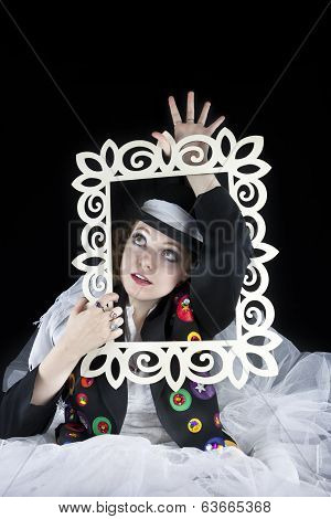 Woman coming out of picture frame
