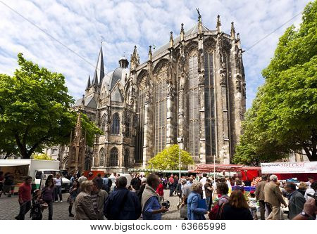 Aachen, Germany - May 5, 2009: Farmers market in front of Aachen cathedral, UNESCO world heritage site.