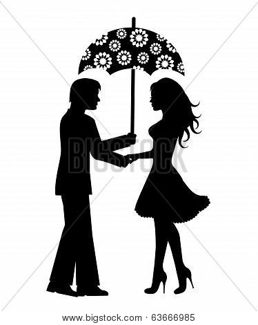 Silhouettes of men and women under the umbrella