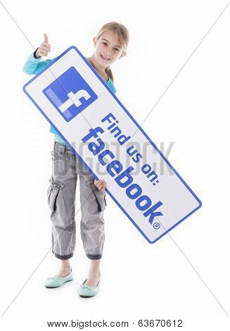Girl holding find us Facebook sign