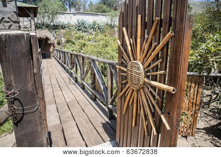 Wooden door with a sun decoration made of sugar canes