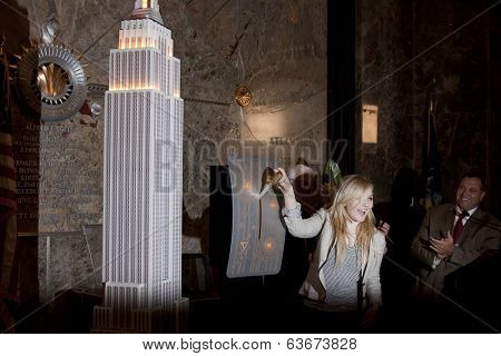 NEW YORK-APR 21, 2014: Actress & Project Sunshine Ambassador Abigail Breslin flips the switch to light the Empire State Building in yellow in honor of Project Sunshine Month.