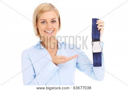 Blonde stewardess in blue shirt showing belt over white